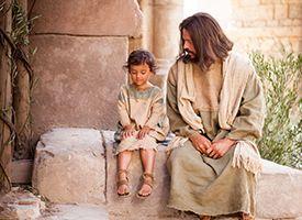 A young jewish boy sits next to the Savior, Jesus Christ.