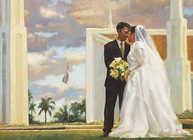 Painting of a bride and groom outside of a temple