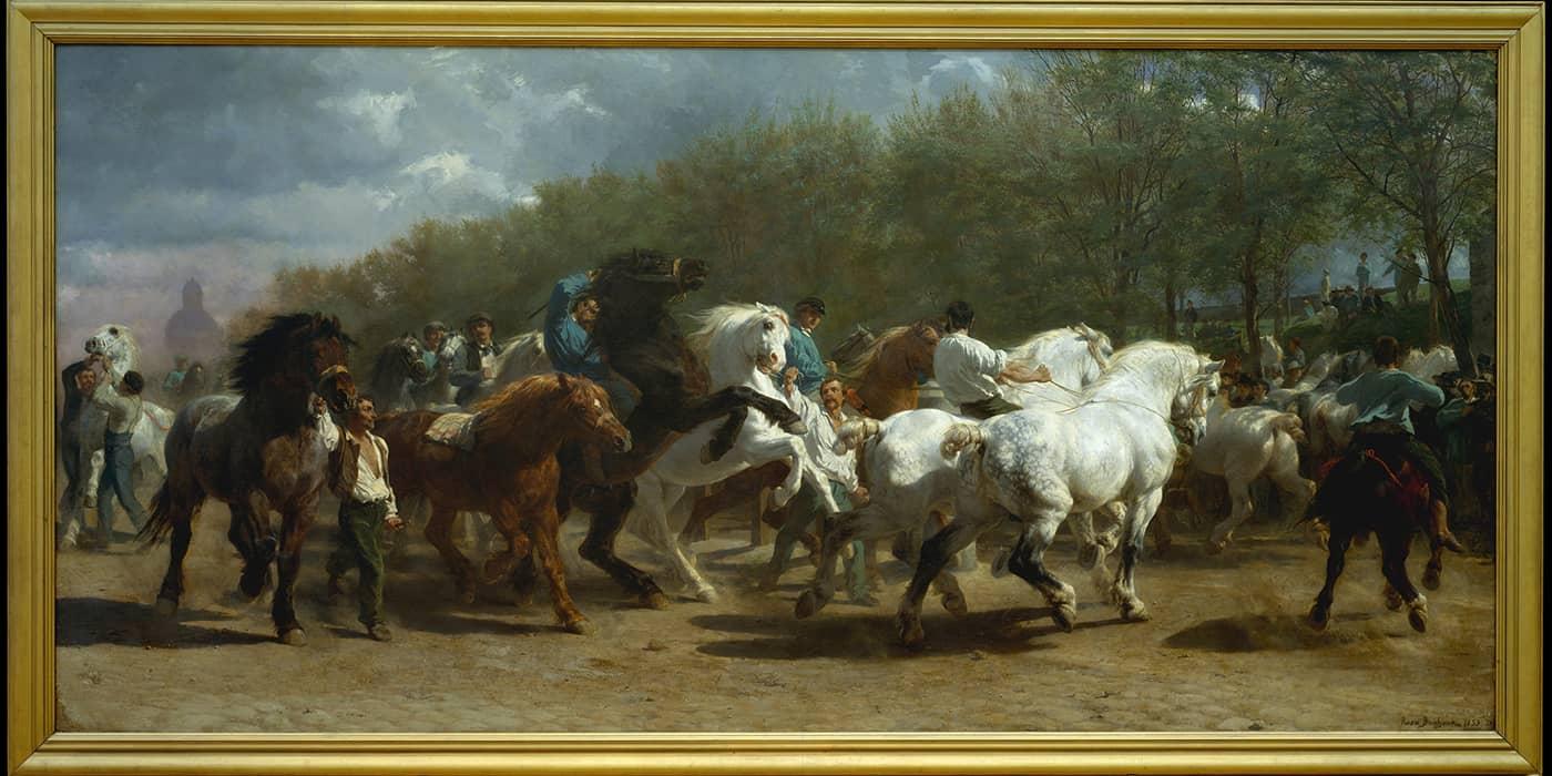 A parade of men on horseback