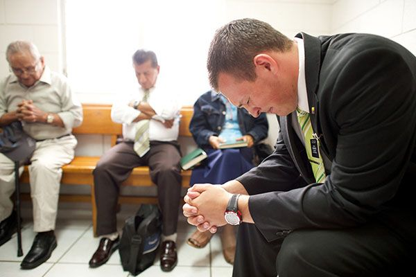 Missionary giving a prayer in Sunday School