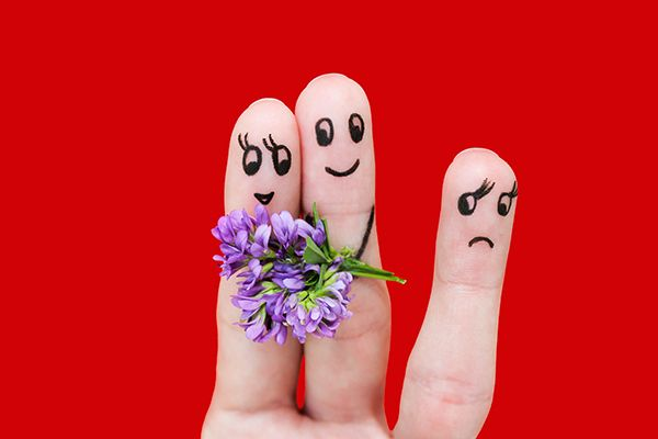 Picture of three fingers representing a couple and one single person