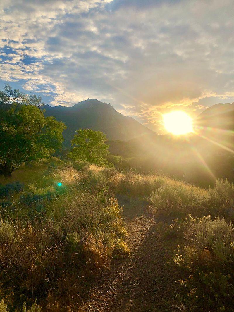 Sunrise shining through the mountains