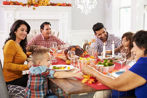 A family enjoying Thanksgiving dinner