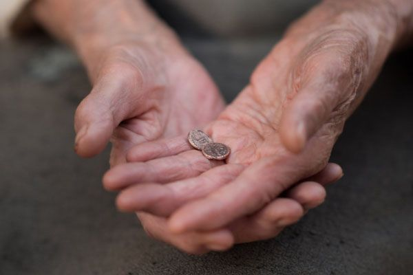 Woman holding two small coins
