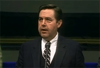 A young Jeffrey R. Holland addresses students at BYU